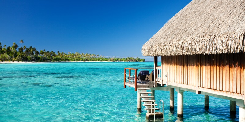 Over water bungalow with steps into lagoon